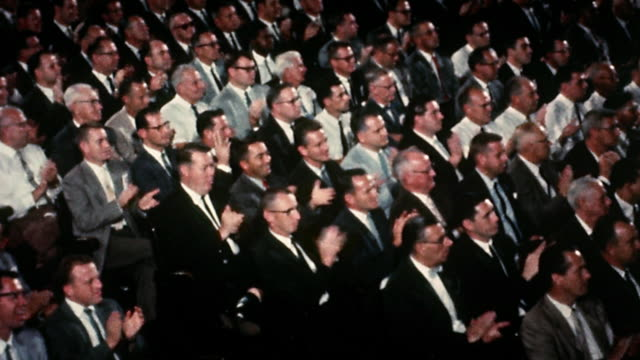 1960s wide shot audience of businessmen in suits clapping - applaudire video stock e b–roll