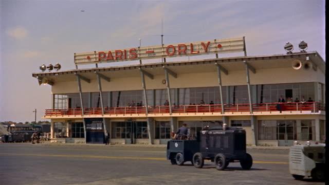 vidéos et rushes de 1960s wide shot exterior of paris orly airport / paris, france - 1960