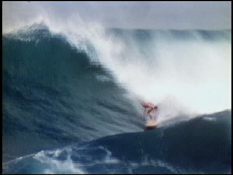 1960s wide shot tracking shot surfer riding large waves / california - surfing stock videos & royalty-free footage