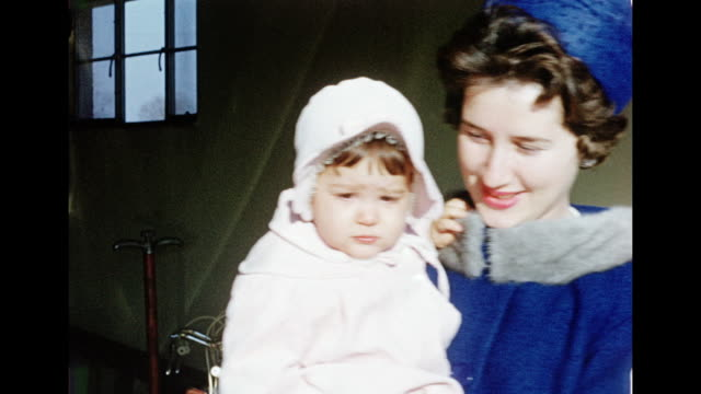 1960s woman carrying her baby - home movie stock videos & royalty-free footage