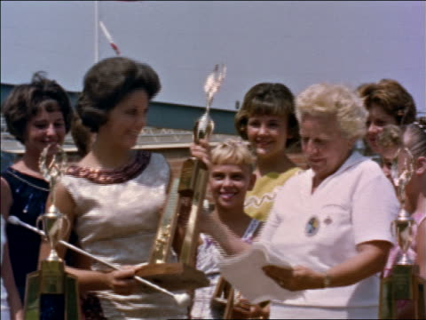 1960s woman giving trophy to majorette as others watch / los angeles / educational - cup stock videos & royalty-free footage