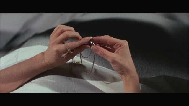 1960s cu woman holding wedding ring - removing stock videos & royalty-free footage