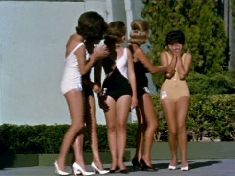1960s woman in swimsuit screams + puts hands over face as she is crowned + others congratulate her - crown headwear stock videos and b-roll footage