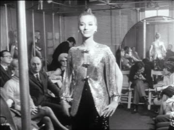 b/w 1960s woman modeling paco rabanne chain mail outfit in runway show / newsreel - sfilata di moda video stock e b–roll