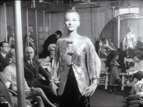 b/w 1960s woman modeling paco rabanne chain mail outfit in runway show / newsreel - sfilata video stock e b–roll