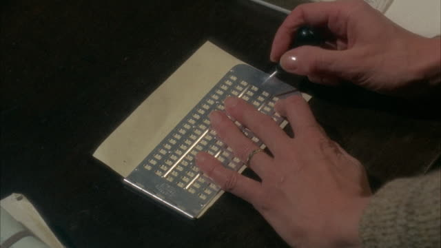 1960s cu woman's hand writing on braille pad - braille stock videos & royalty-free footage
