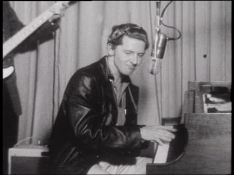 b/w 1960s zoom in zoom out close up jerry lee lewis singing great balls of fire while playing piano on radio show - early rock & roll stock videos & royalty-free footage