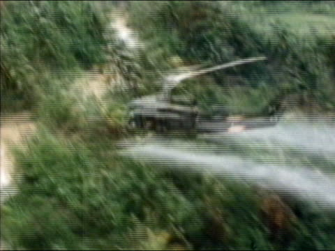 1960s-1970s aerial us military helicopter spraying agent orange over jungle / vietnam - vietnam stock videos & royalty-free footage