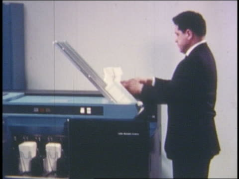 1960s/70s man loading cards into blue computer - punch card reader stock videos & royalty-free footage
