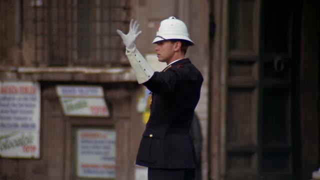 1960s/70s medium shot police officer directing traffic / rome, italy - rome italy video stock e b–roll