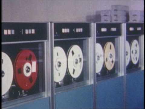 1960s/70s row of computer reels turning - mainframe stock videos & royalty-free footage