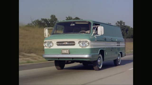 WS TS 1962s Man driving van on road / United States