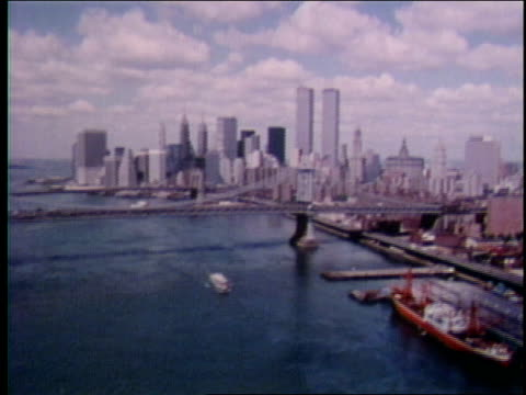 1970s aerial ws downtown manhattan skyline including wtc towers/manhattan bridge and brooklyn bridge over new york harbor - 1975 stock videos and b-roll footage