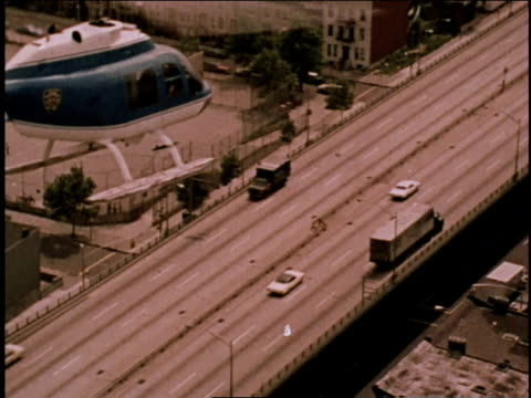 1970s AERIAL Helicopter following hijacked truck on highway below / Brooklyn, New York, United States