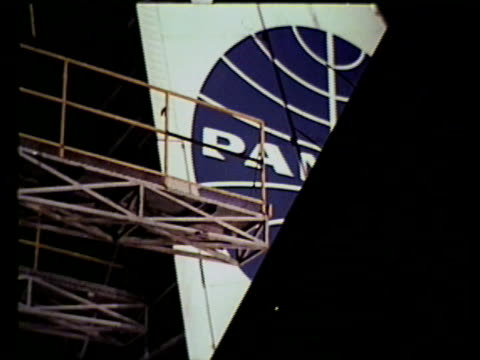 airplane repair la cu elevated platform moving into position on tail of pan am airplane ms technicians engineer examining airplane part ms man w/... - airplane part stock videos and b-roll footage