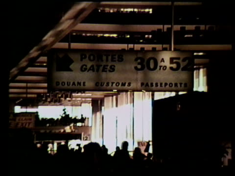 airport ms gates 30 to 52 sign people walking through airport ext ms airplane tails w/ pan am logo vs radio tower airplane stairs ms parked pan am... - flugpassagier stock-videos und b-roll-filmmaterial
