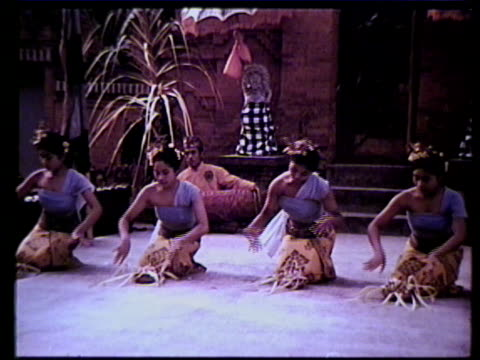 female balinese dancers performing, temple. vs topless woman washing net, young boy carrying basket on head. vs dancers. vs boy climbing tree stump,... - balinese culture stock videos & royalty-free footage