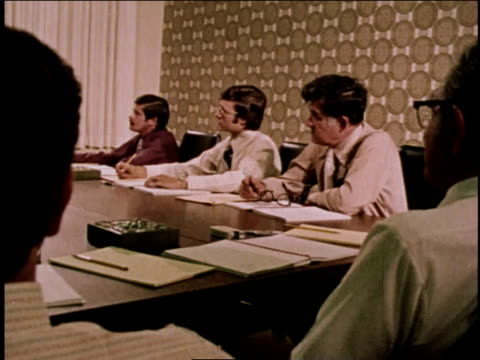 1970s ms business men sitting at table listening to seminar / new york, united states - seminar stock videos & royalty-free footage