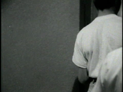 1970s b/w montage boy arriving at juvenile hall, los angeles, california, usa, audio - männlicher teenager allein stock-videos und b-roll-filmmaterial