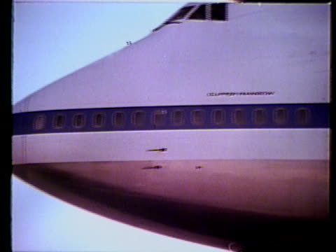 commercial airplane ms slo dolly from nose toward tail of clipper rainbow pan am logo on side of commercial airliner wings engine windows closed... - airplane tail stock videos and b-roll footage