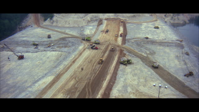 1970s ls ws ha construction equipment working on dam in mountain area - 1972 stock videos and b-roll footage