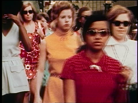 1970s crowd of women walking on NYC street / documentary