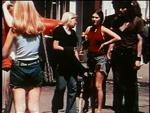 vídeos de stock, filmes e b-roll de 1970s group of people in shorts with dog on nyc street / documentary - documentário
