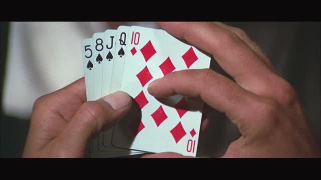 1970s cu hands holding playing cards - poker card game stock videos & royalty-free footage
