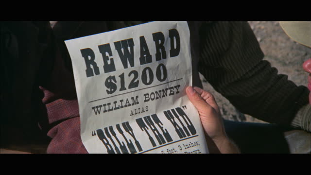 1970s cu hands holding wanted poster - poster stock videos & royalty-free footage
