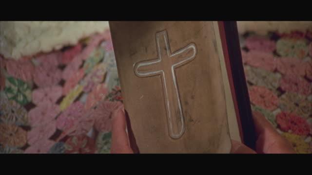 1970s CU Hands opening bible