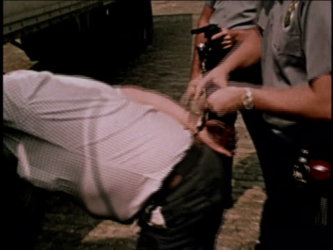 1970s ms hijacker being handcuffed by police / brooklyn, new york, united states - arrest stock videos & royalty-free footage