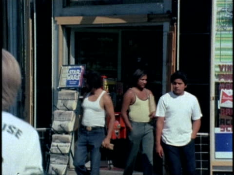 1970s ws td pan men exiting liquor store, los angeles, california, usa, audio - liquor store stock videos and b-roll footage
