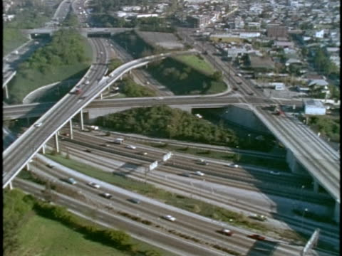 1970s montage aerial view of city with highways / los angeles, california - 1975 stock videos and b-roll footage