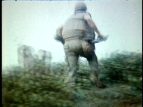 1970s montage american soldiers running in battlefield and taking cover / vietnam - vietnam war stock videos & royalty-free footage