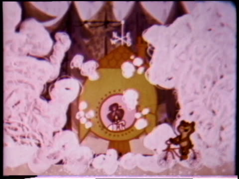 vídeos de stock, filmes e b-roll de 1970s montage animated post cereals sugar crisp commercial featuring a bear and old woman / united states - cereal