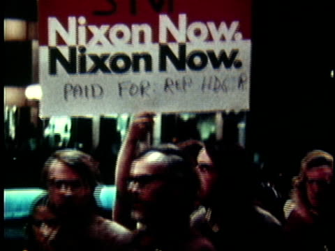 vídeos de stock, filmes e b-roll de 1970s montage anti-vietnam war protestors marching on street holding up ant-richard nixon placards / united states - richard nixon