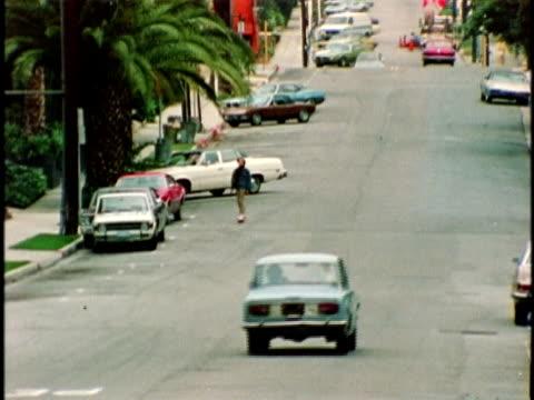 vídeos y material grabado en eventos de stock de 1970s montage boy skateboarding down street, los angeles, california, usa, audio - california