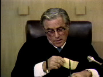 1970s montage courtroom scene with judge reading documents / los angeles, california / audio - legal trial stock videos & royalty-free footage
