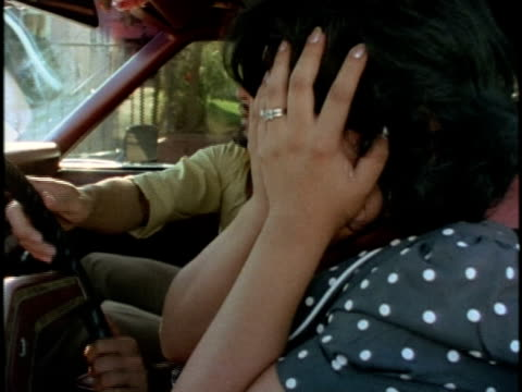 1970s montage distressed woman having driving lesson with instructor, los angeles, california, usa, audio - augen zuhalten stock-videos und b-roll-filmmaterial