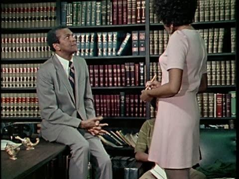 1970s montage lawyer talking to teenage boy in office, secretary bringing files, los angeles, california, usa, audio - 法律制度点の映像素材/bロール