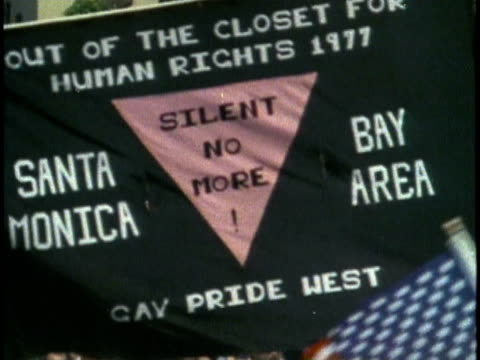 1970s MONTAGE Los Angeles Gay Pride Parade / WS People carrying 'Christopher Street West' banner / CU 'Silent No More' banner / MS Men marching...