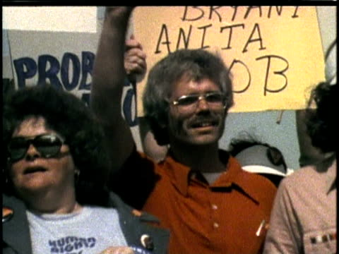1970s montage los angeles gay pride parade / ws people carrying 'christopher street west' banner / cu marchers / ws people with 'gay community... - 1970 stock videos & royalty-free footage