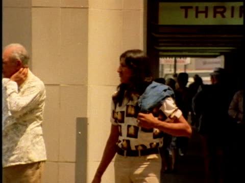1970s montage man walking through los angeles streets, california, usa, audio - long hair stock videos & royalty-free footage