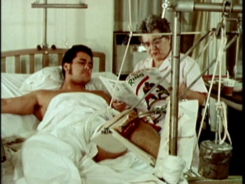 1970s montage nurse and patient browsing magazine together hospital, los angeles, california, usa, audio - ギプス点の映像素材/bロール