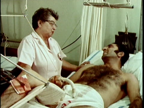 1970s montage nurse talking to patient in cast, los angeles, california, usa, audio - ギプス点の映像素材/bロール