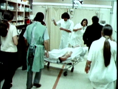 1970s MONTAGE Patient being transported to hospital, Los Angeles, California, USA, AUDIO