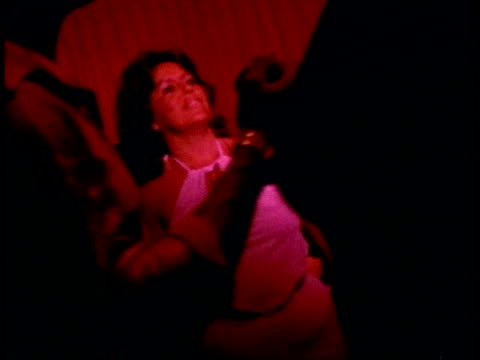 1970s MONTAGE People in bar dancing and drinking, Los Angeles, California, USA, AUDIO