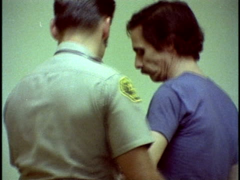 1970s montage cu police officer putting man into jail cell, los angeles, california, usa, audio - crime or recreational drug or prison or legal trial video stock e b–roll