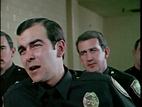 1970s MONTAGE Police officers talking, Los Angeles, California, USA, AUDIO