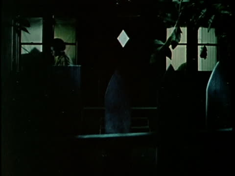 1970s montage silhouette of burglar looking through window into house at night, los angeles, california, usa, audio - males stock videos & royalty-free footage